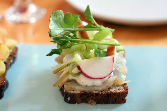 aamans copenhagen - smørrebrød with gravad white fish served with a summer salad of goat milk yogurt, cucumber, apples, celery and watercress