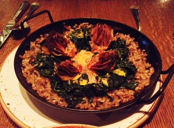 kale and wild mushroom paella with crispy artichokes and egg