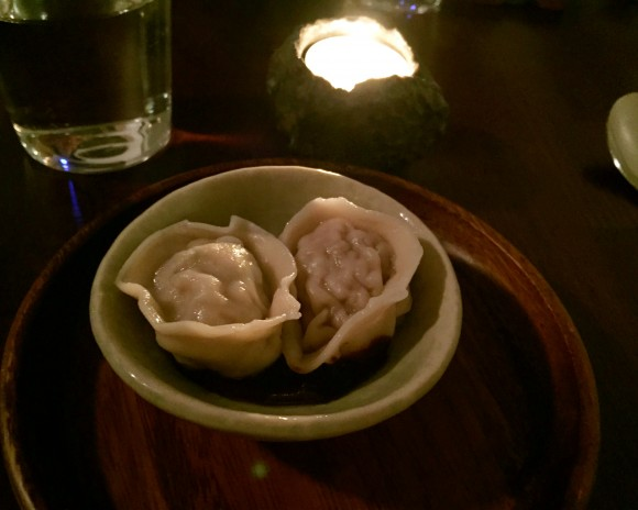 lamp dumplings with black garlic sauce