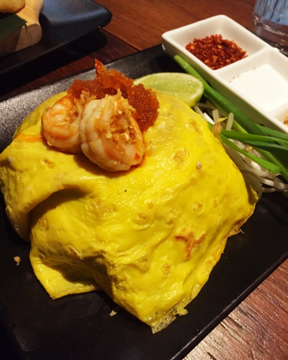 pad thai with shrimp wrapped in egg crepe