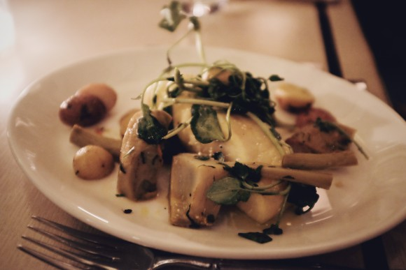 poached halibut with artichokes, baby potato, olive tapenade, turmeric oil