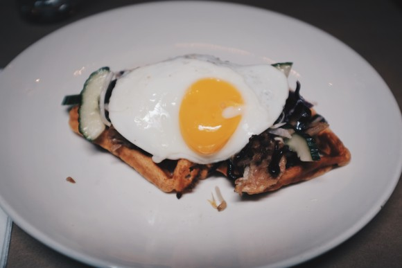 kimchi waffles with roasted pork shoulder, asian salad and pickled chilies. and of course an egg on top!