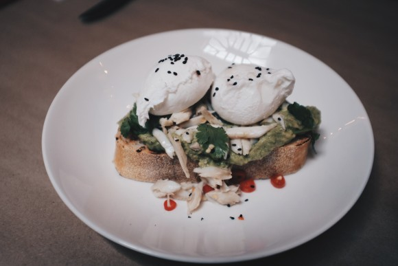 togarashi spiced avocado on toast with maryland crab, pickled chilies and cilantro