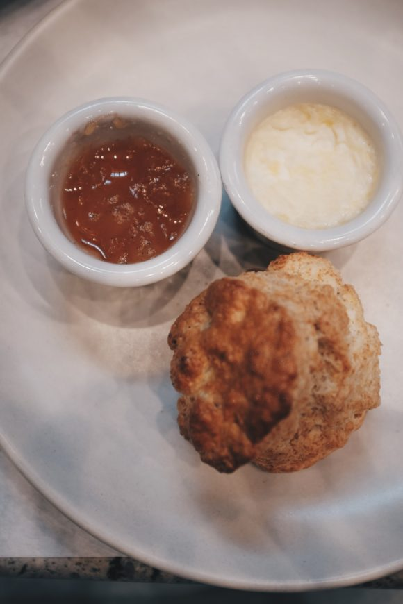 scone with marmalade and honey butter