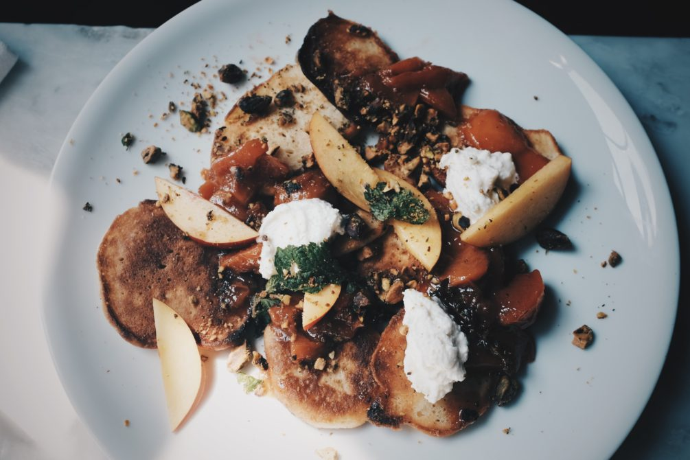 cast-iron pancakes with peaches, ricotta and pistachio
