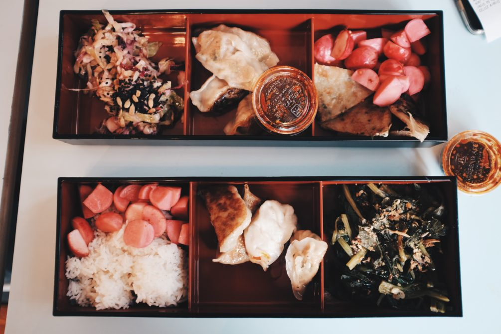 bento boxes - taipei tapas with scallion pancake, market vegetables, homemade pickles and dumplings on top, hearty home with rice, taiwanese greens, homemade pickles and dumplings on the bottom